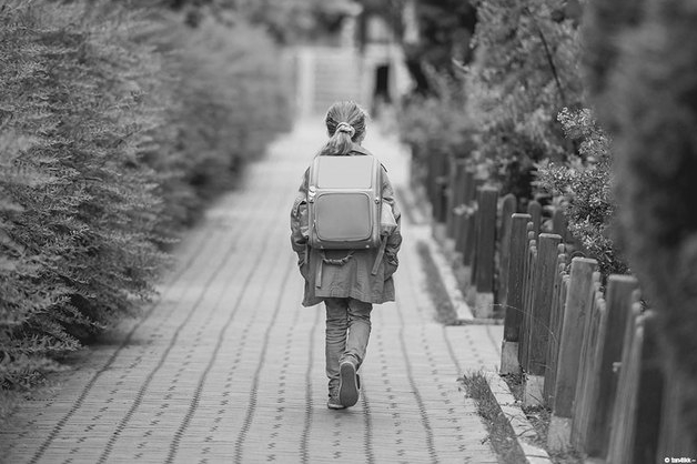 girl walking with backpack
