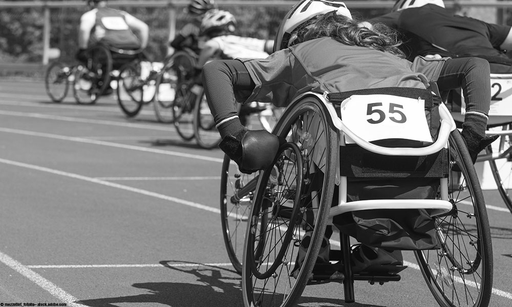 Runner in wheelchair.