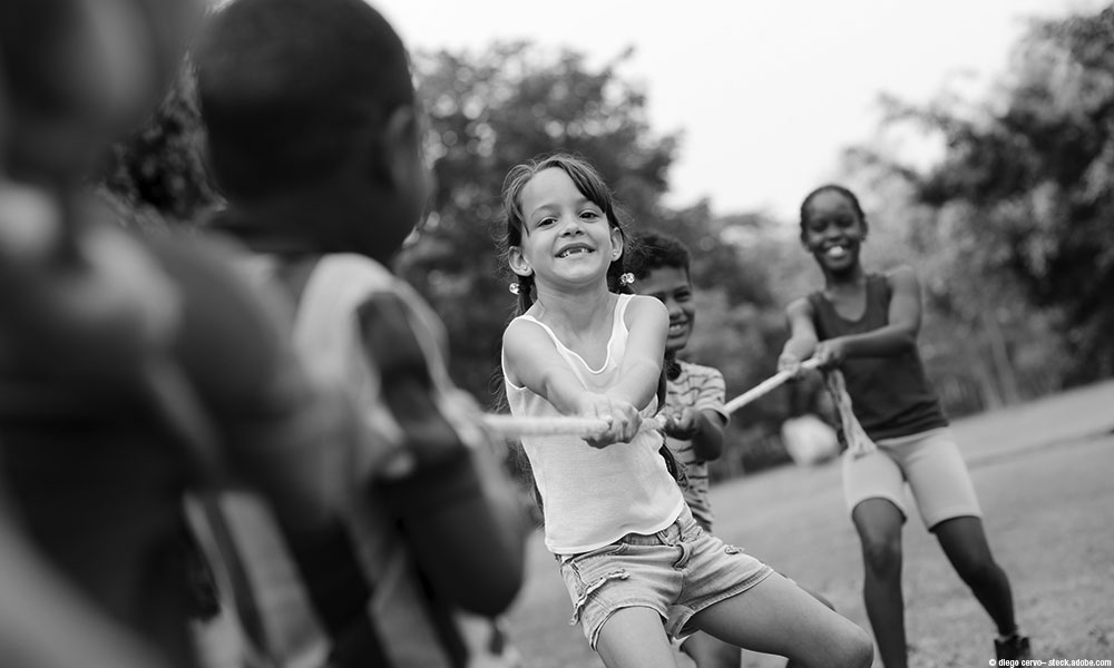 image of kids playing tug of war