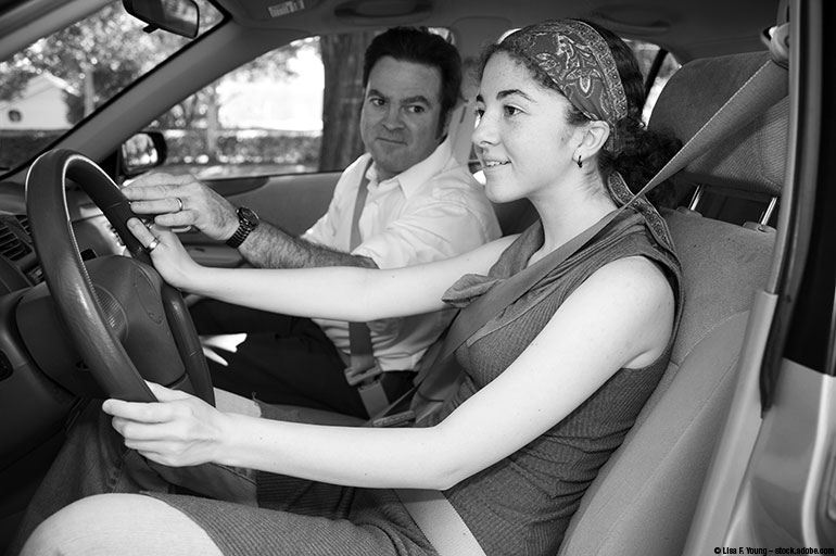 image of a girl driving with her dad