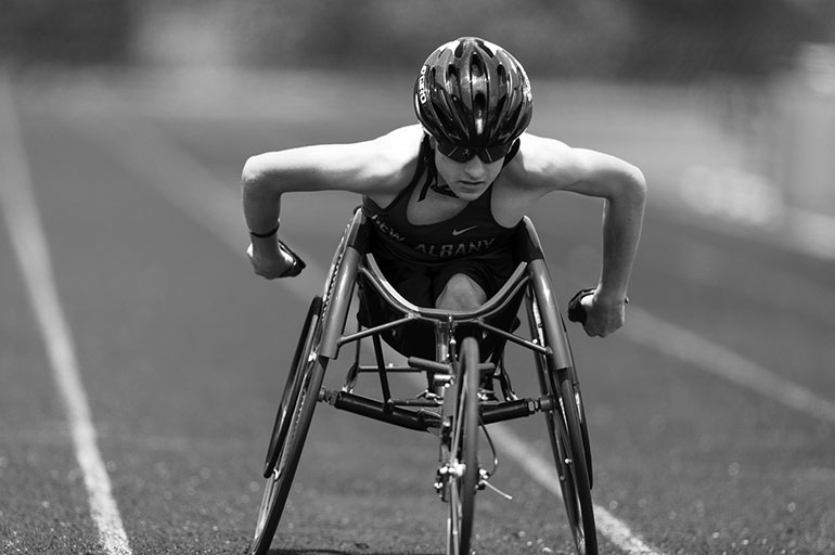 image of wheelchair athlete on a track