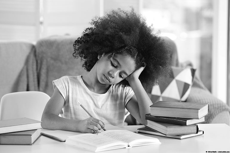 image of a girl doing homework looking frustrated