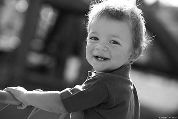 image of a smiling toddler boy