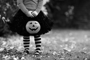 Child wearing Halloween costume, trick-or-treating