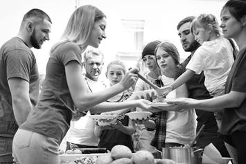 Teens volunteering at a soup kitchen