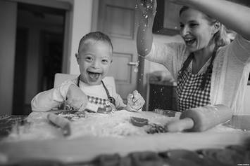 Caregiver and child cooking in the kitchen