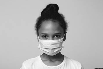 Little girl wearing face mask