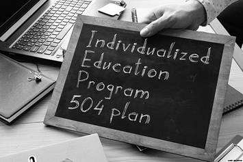 "Chalkboard sign that says ""Individualized Education Program 504 Programs"""