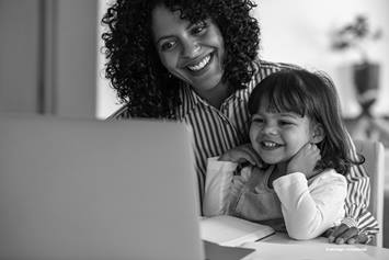 Mother and daughter looking at computer screen
