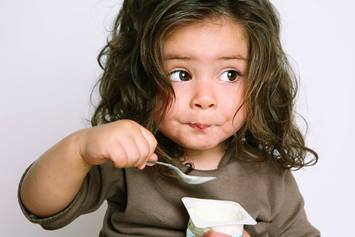 Little Kid Eating Yogurt