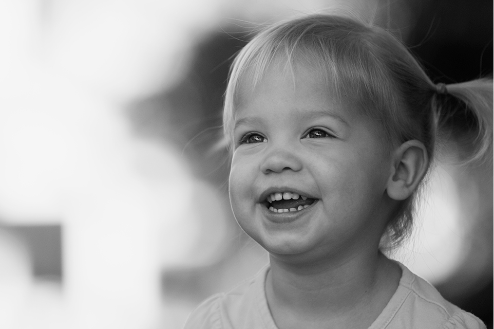 Little girl with pigtails smiling
