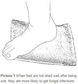 drying foot on a towel after showering
