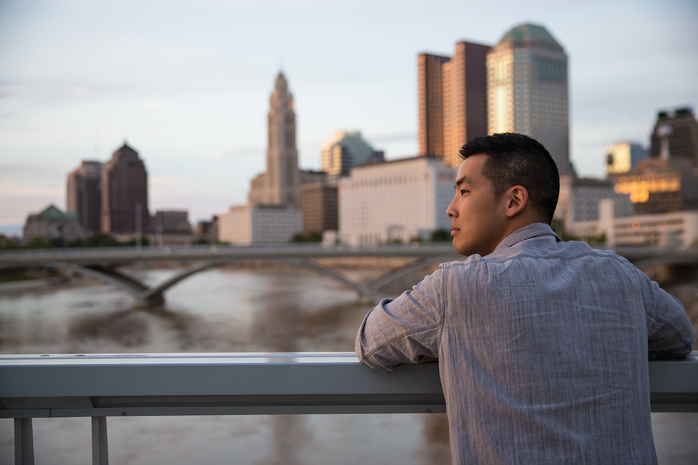 Young Man Looking at the Columbus Skyline
