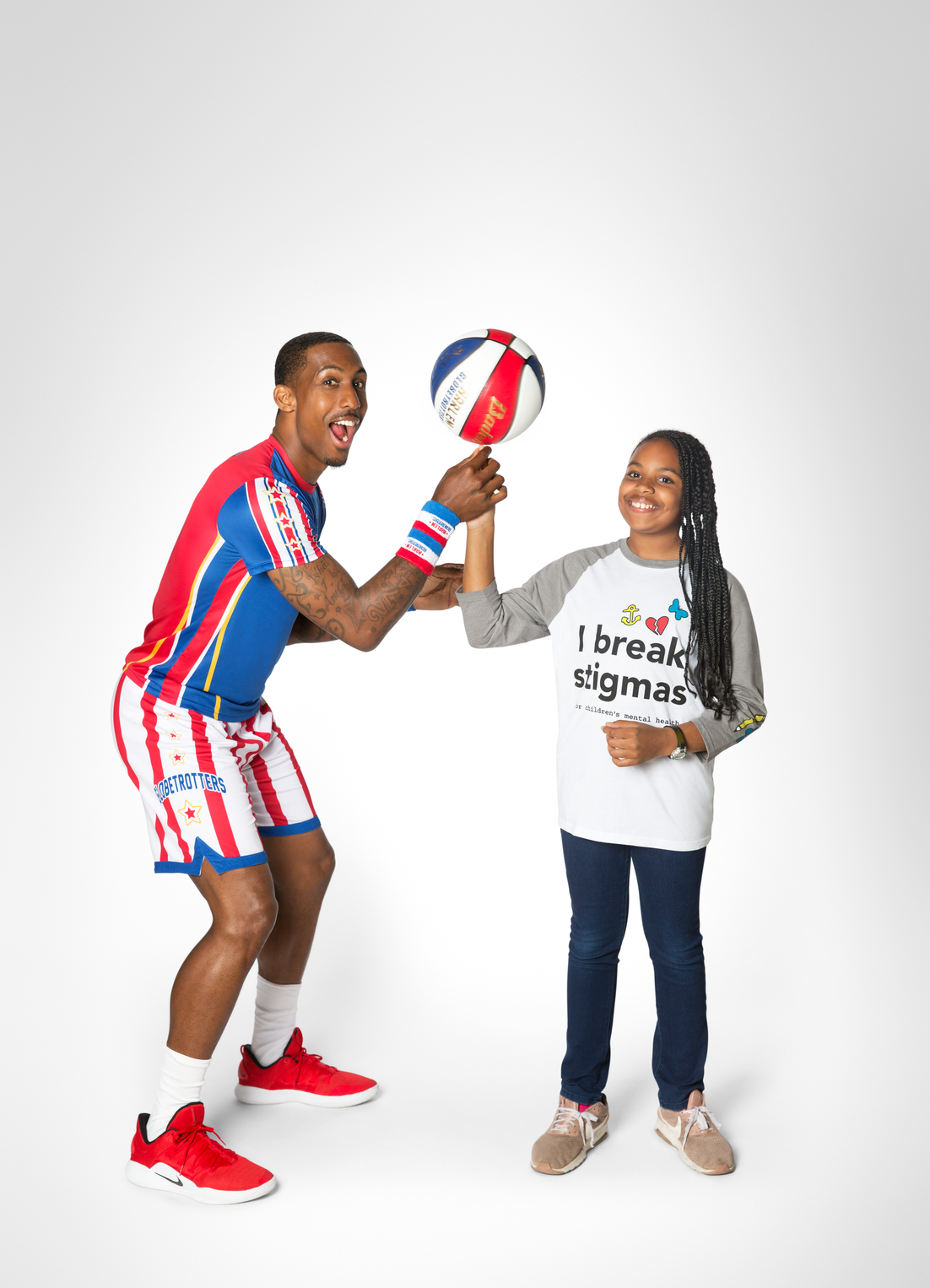 Harlem Globetrotter and Child