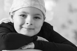 Young smiling cancer patient wearing head wrap