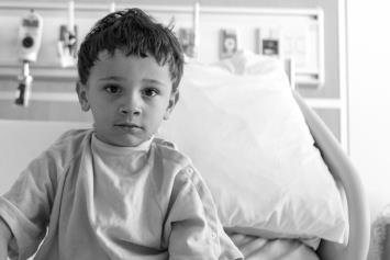 Young boy in hospital bed
