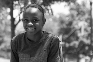 Preteen Girl Sitting Outside and Smiling