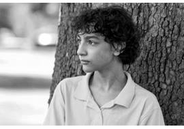 Preteen Boy Leaning on Tree