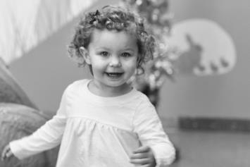 Toddler Girl Running Toward Camera Smiling