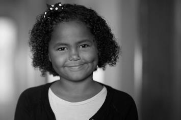 Young Girl Smiling in Hallway