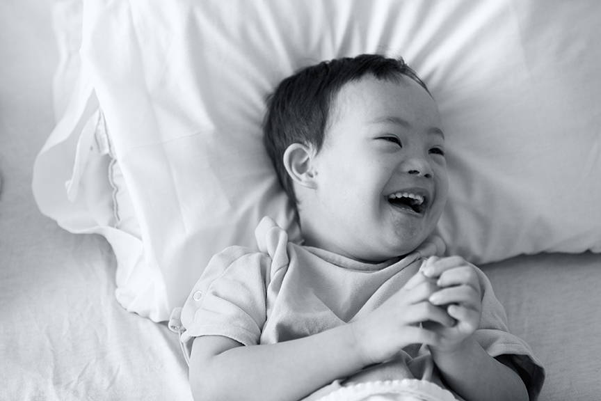 Laughing boy in hospital bed