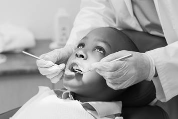 Child undergoing a dental procedure