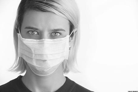 Female health care provider wearing a face mask