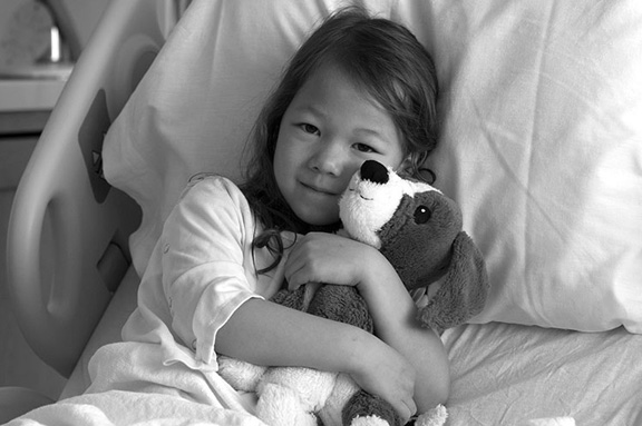 Young girl in hospital bed