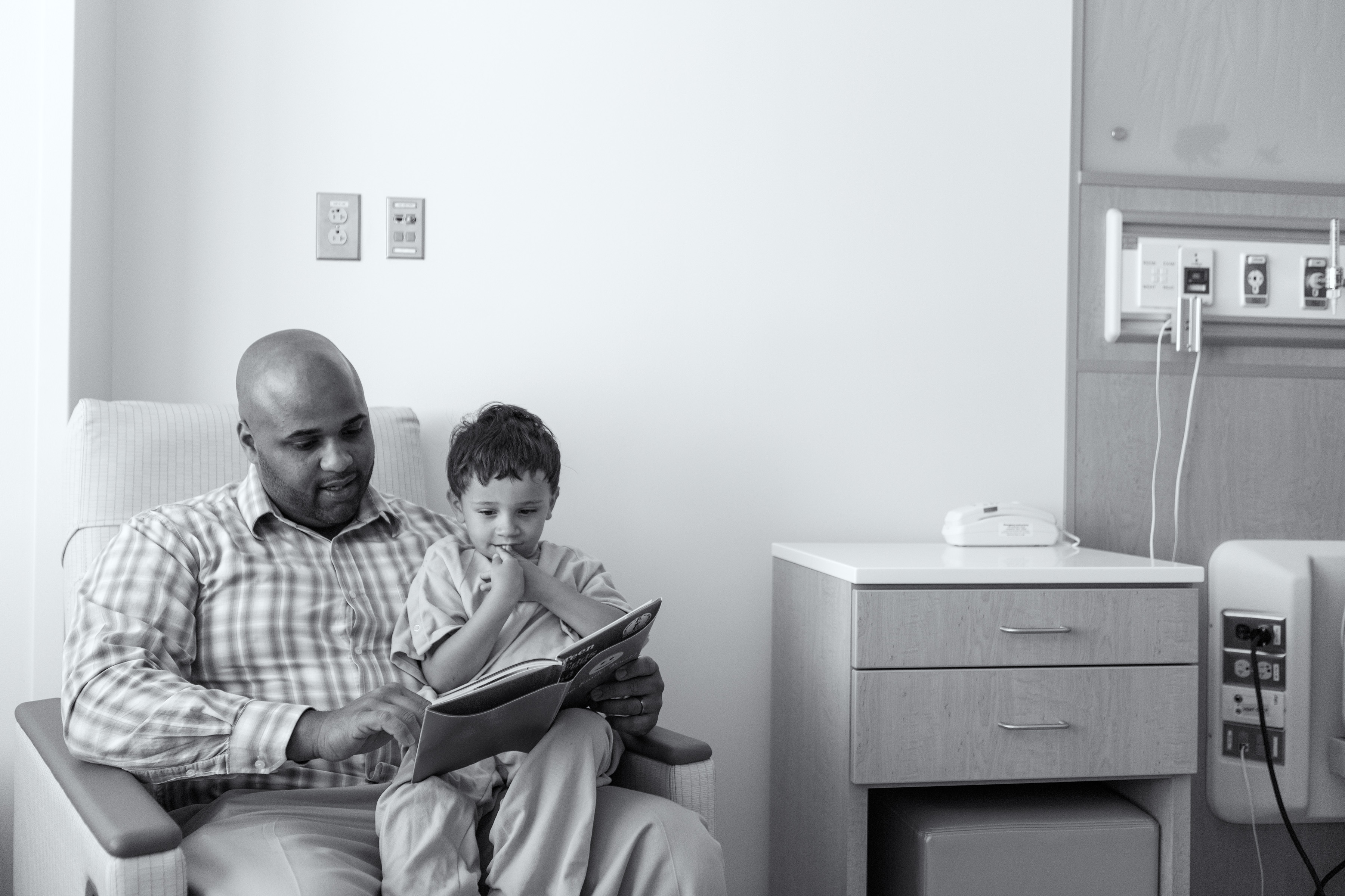 Father Reading to Patient